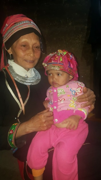 Dao woman with granddaughter (Ha Giang province, Vietnam)